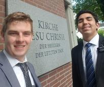 Missionaries in front of Church Sign