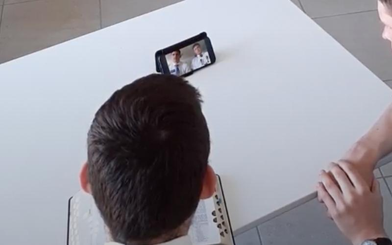missionaries teaching through smartphone