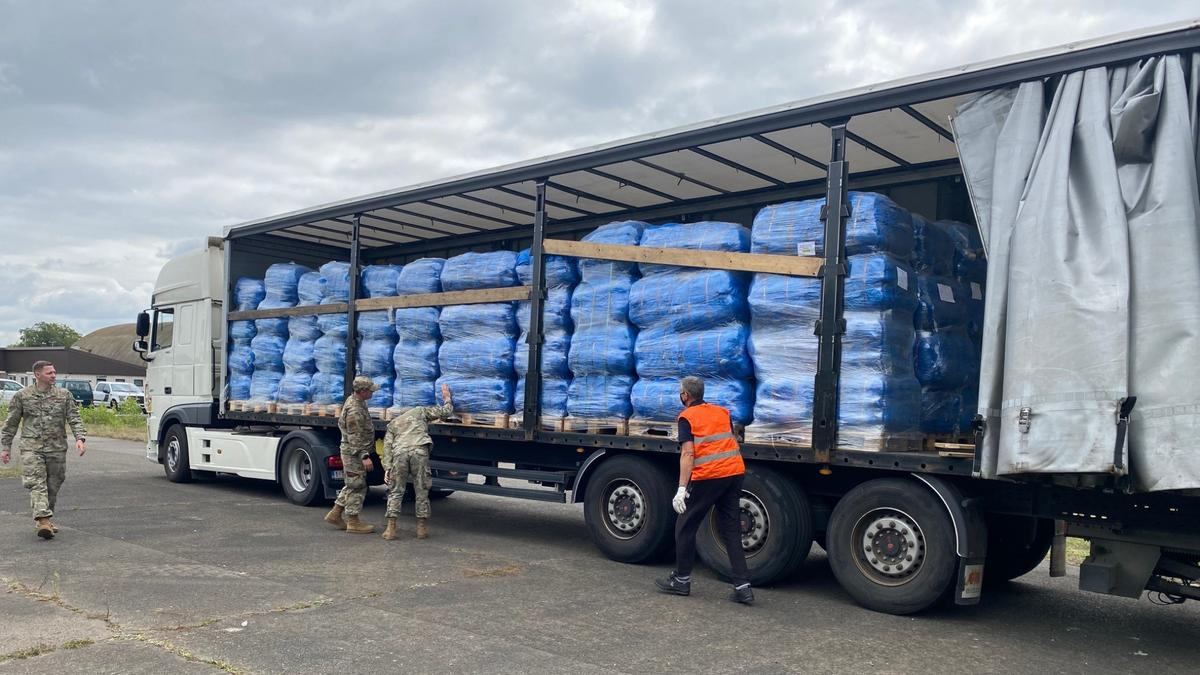 A truck delivers blankets from Latter-day Saint Charities to Ramstein Air Base in Germany