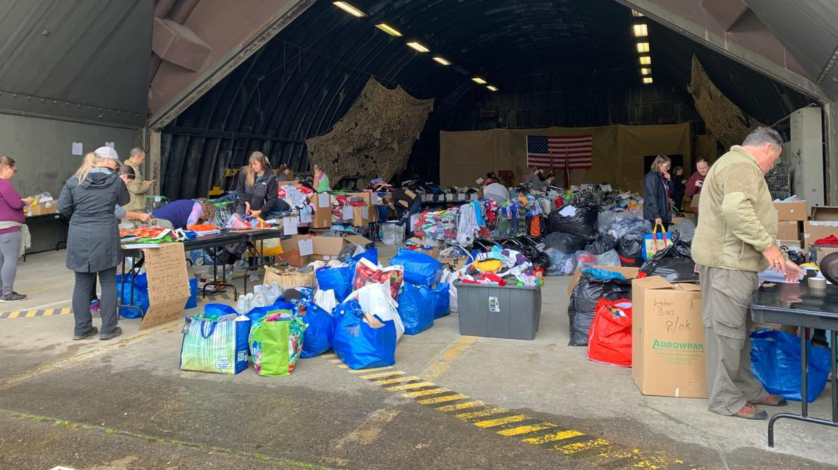 Volunteers at Ramstein Air Base in Germany organize items for Afghan refugees in August 2021