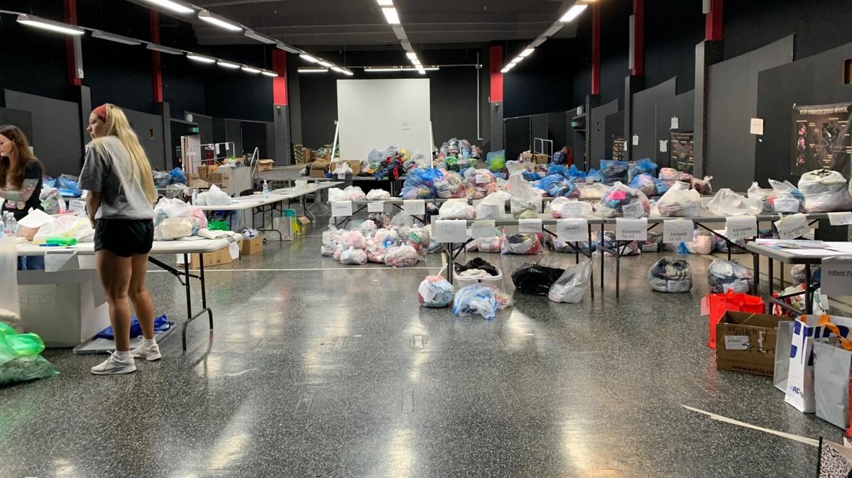 Volunteers at Ramstein Air Base in Germany organize items for Afghan refugees donated by Latter-day Saint Charities