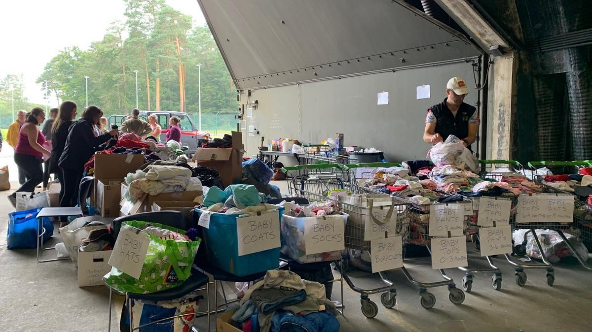 Volunteers at Ramstein Air Base in Germany organize items for Afghan refugees in August 2021.