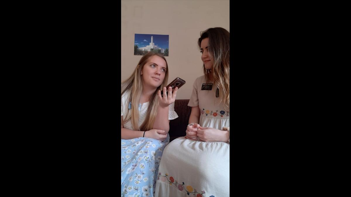 Sister Missionaries in a phone call