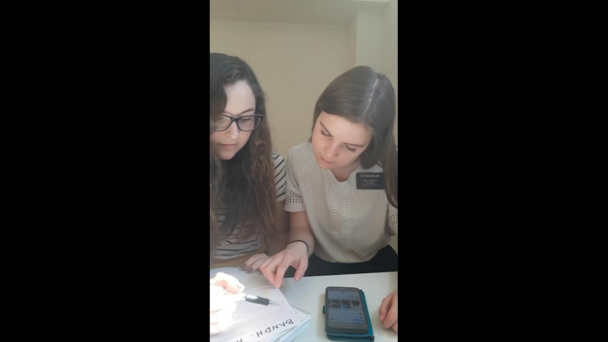 Sisters reviewing a list