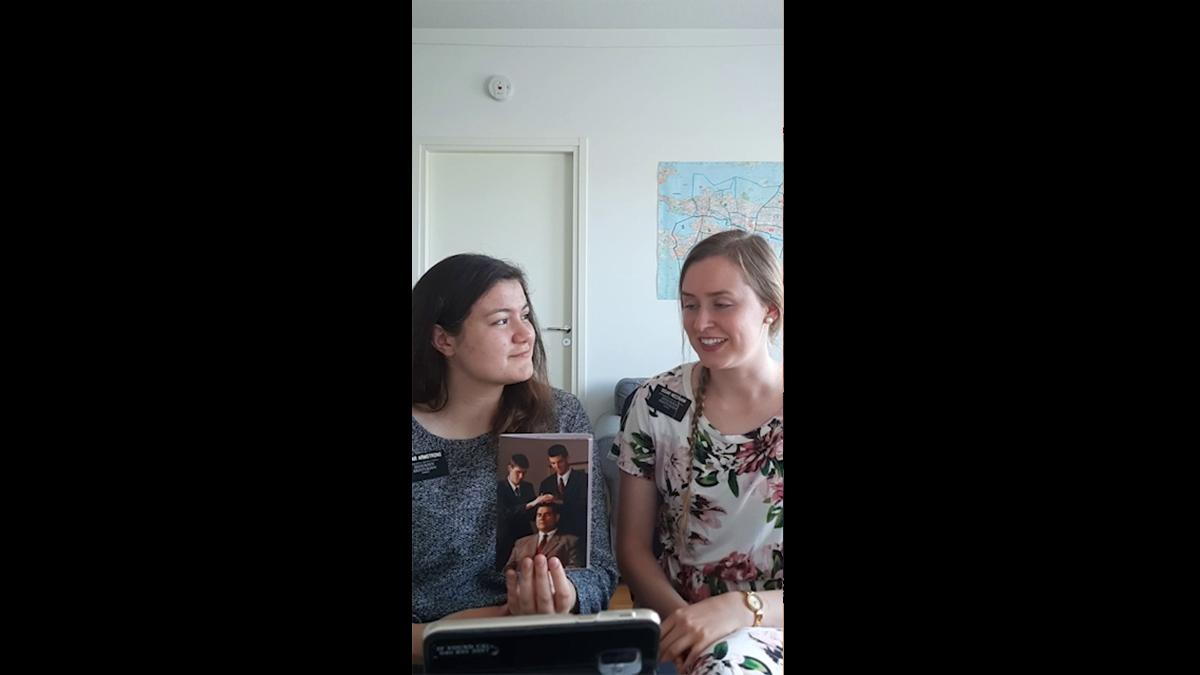 Two Sister Missionaries teaching with a pamphlet.