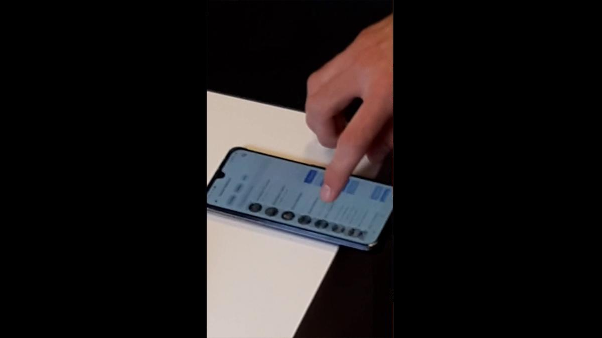 A finger scrolling through a Facebook Friends List.