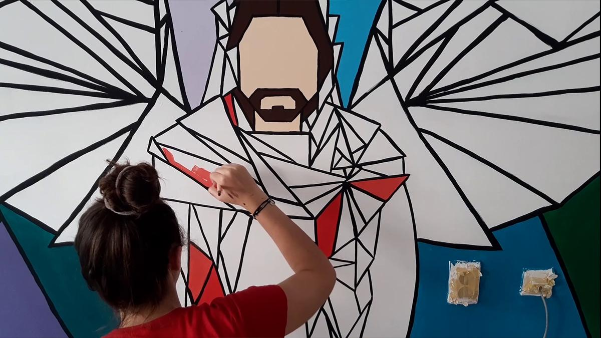 Sisters paint a mural as a service project in Belgrade, Serbia