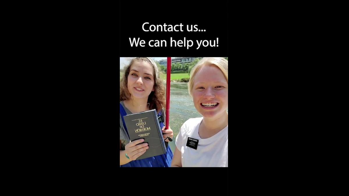 Two Sister Missionaries with a Book of Mormon smile into the camera. A slogan above them says 'Contact us... We can help you!'