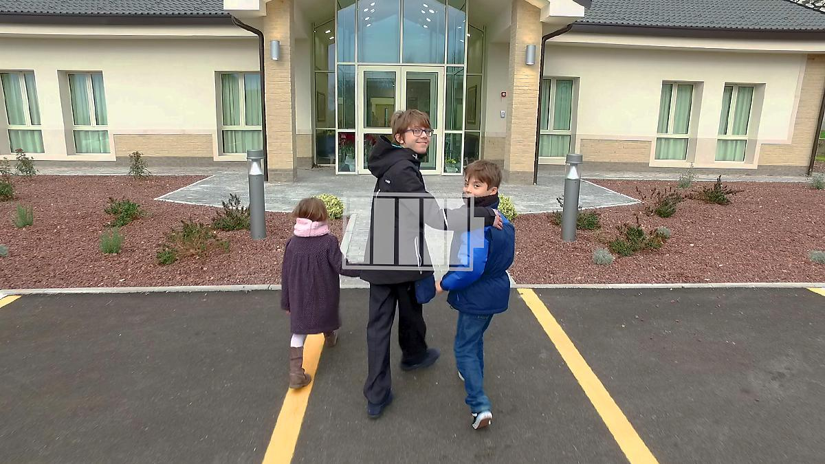 kids enter a church building
