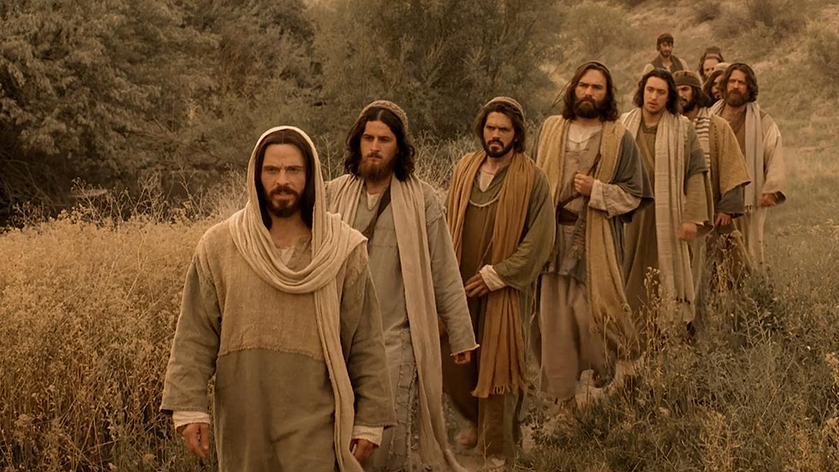 Jesus Christ leading his disciples.