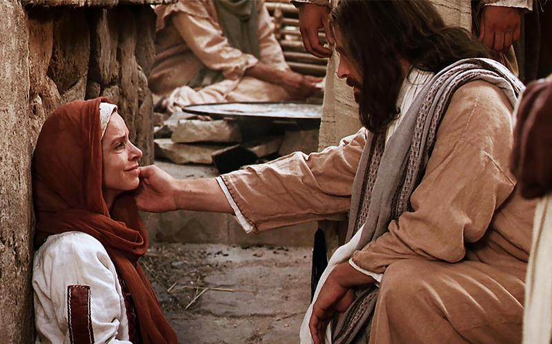 Jesus Christus tröstet die gläubige Frau