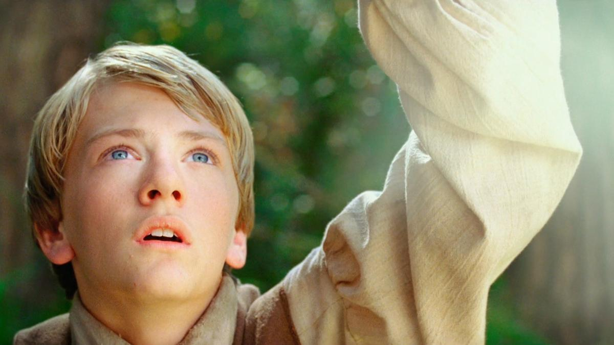 Joseph Smith privește un stâlp de lumină.