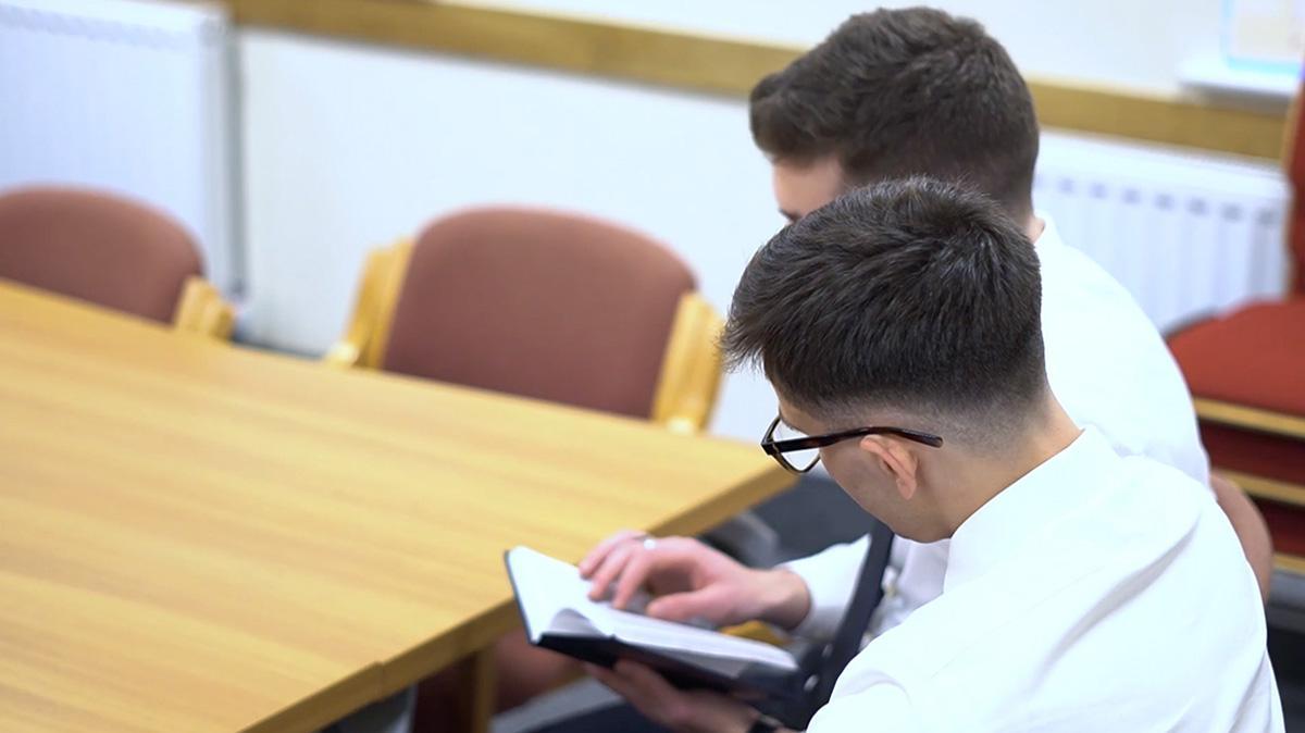 2 Elders reading a manual