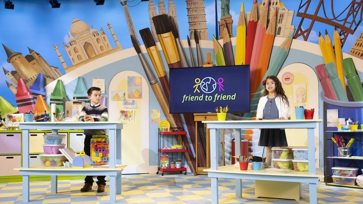 a boy and a girl presenting the broadcast