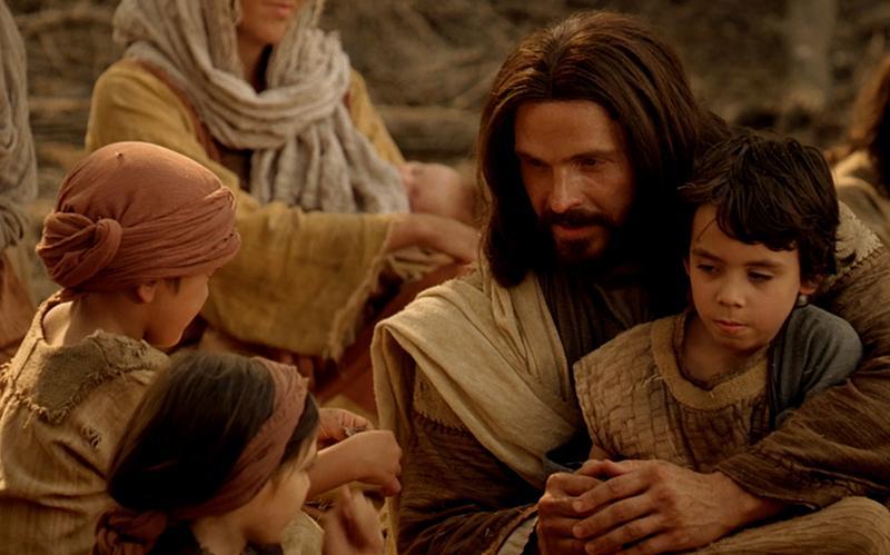 Frelseren med et barn på sit knæ