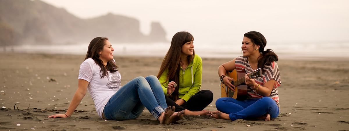 youth singing at the beach