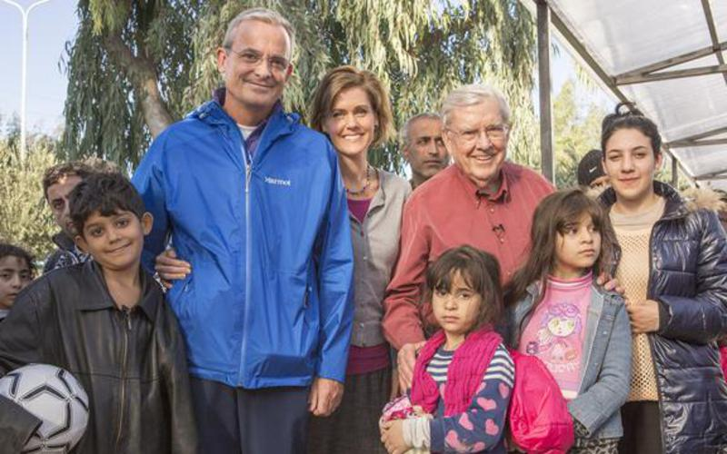 Elder Ballard, Elder and Sister Kearon with refugees