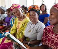 women at church singing hymns