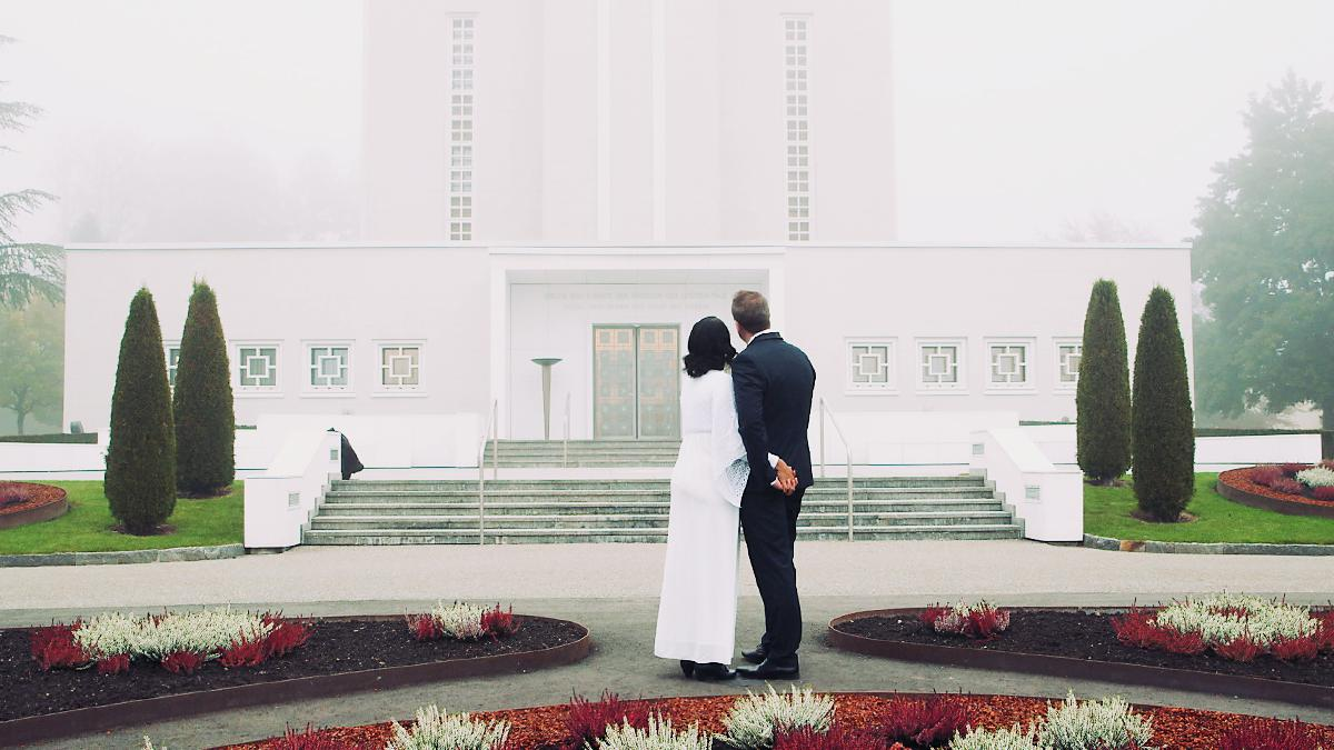 a couple in front of the Switzerland temple