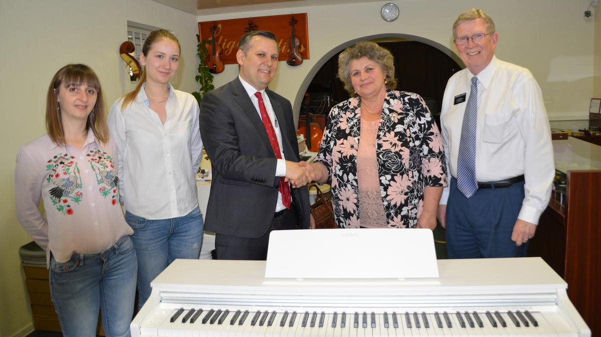 Church_presents_piano_gift