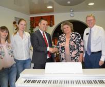 Church_presents_piano-gift