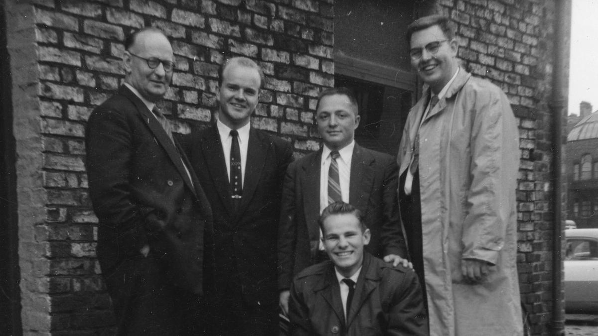 Pres Oates on the left outside his printers with some of the missionaries taken around 1958