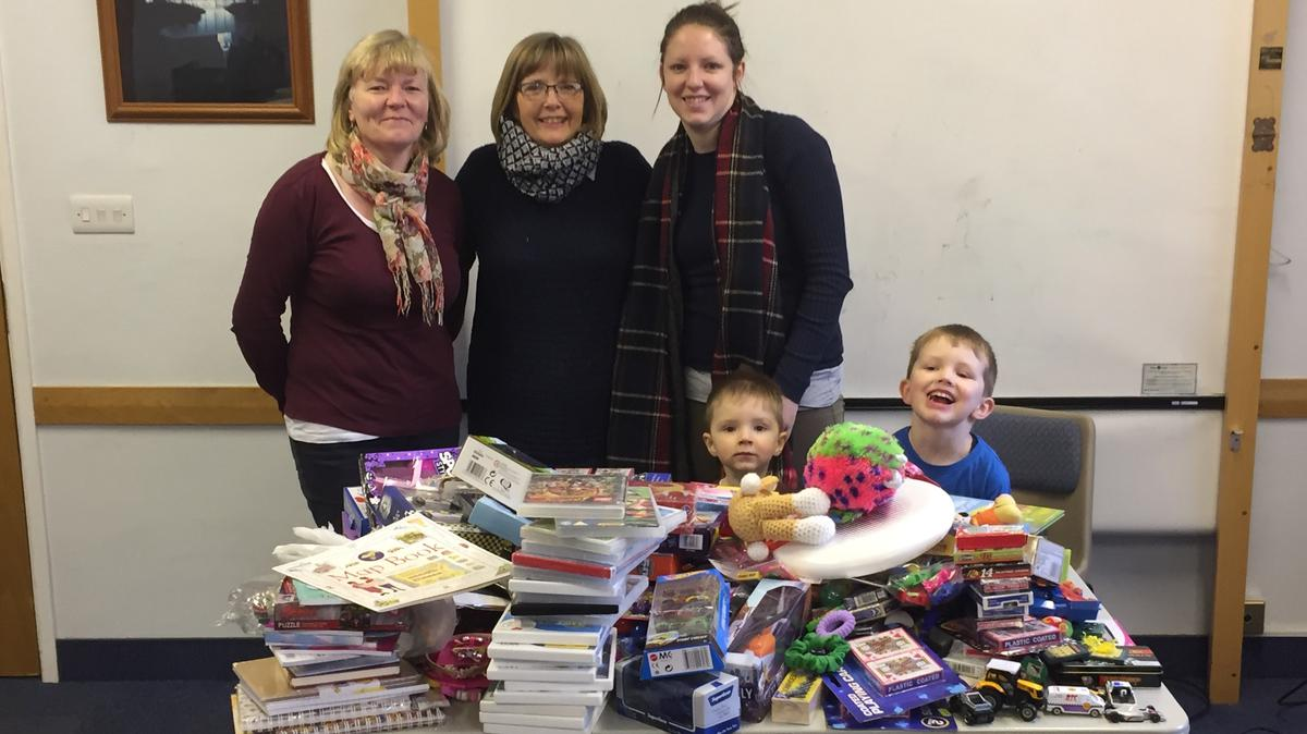 From L to R - Linda Good, Shirley Boycott and Jemma Sanderson with Jeremy and Harvey Sanderson displaying some of the donated goods which were sent to Bulgaria