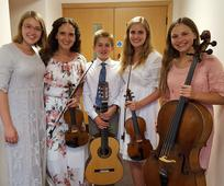 Left to right: Hannah Baker, Jenny Oaks-Baker, Matthew Baker, Laura Baker, Sarah Baker