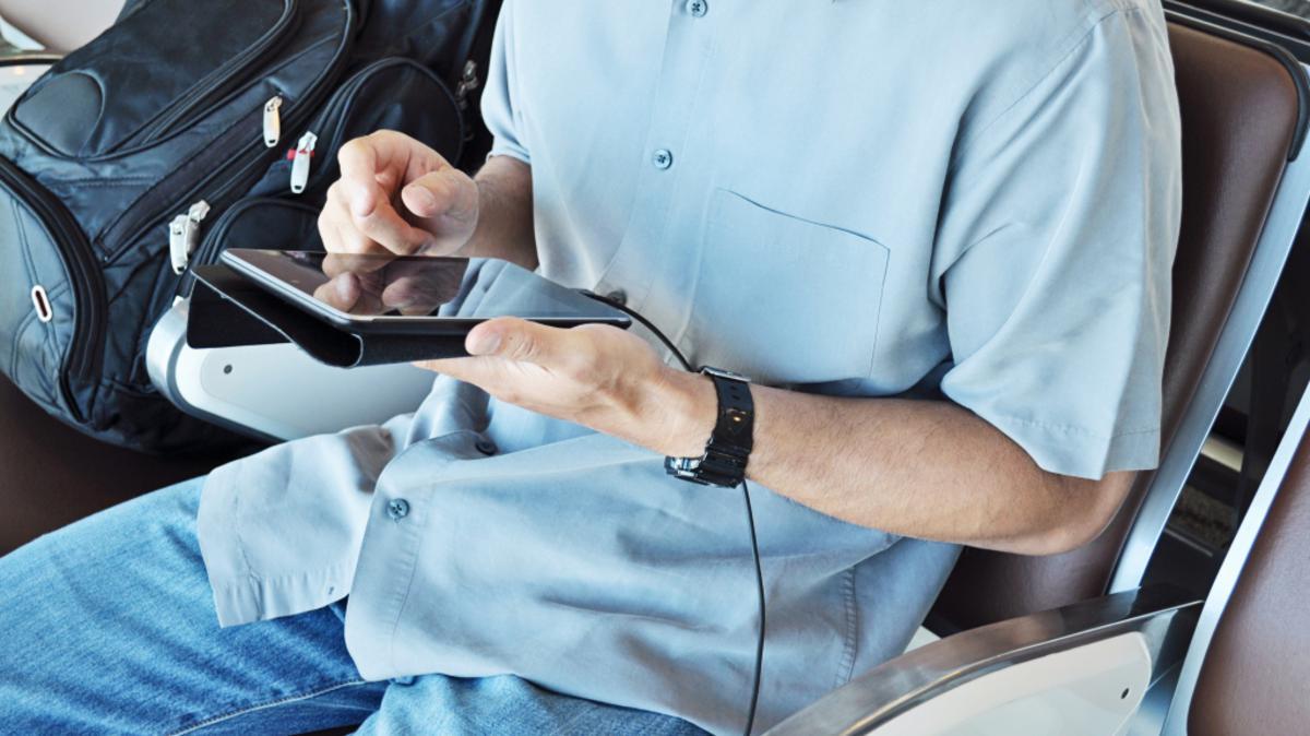 A man browsing social media on a tablet
