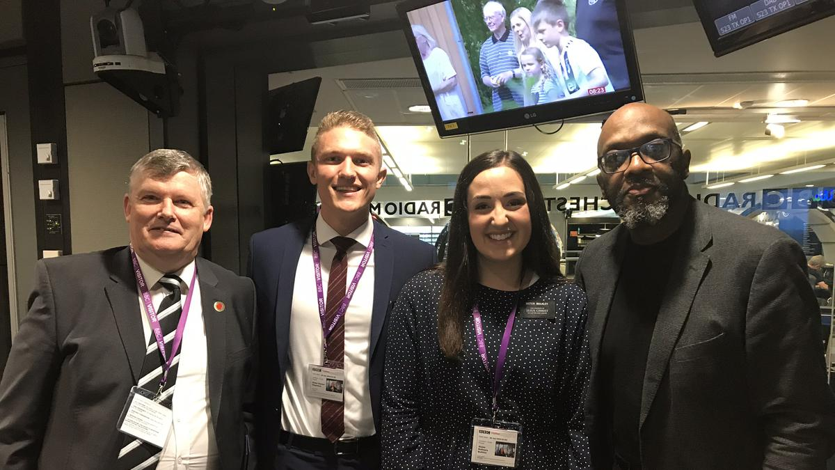 Radio presenter Mike Shaft pictured with Sister Bulkley and Elder Stephens of the England Manchester Mission accompanied by Kevin Fletcher, multi-Stake Director of Public Affairs and Communications.