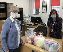 Sister Marie Giles delivering hats and blankets to Poole Maternity Unit