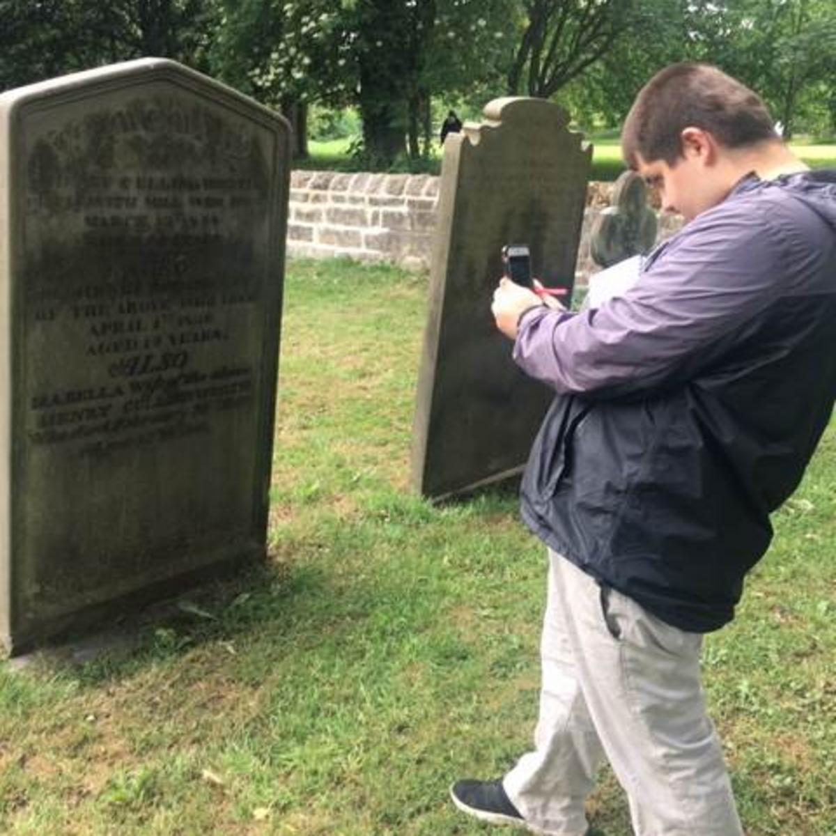 Elder Mahaffey taking pictures of graves