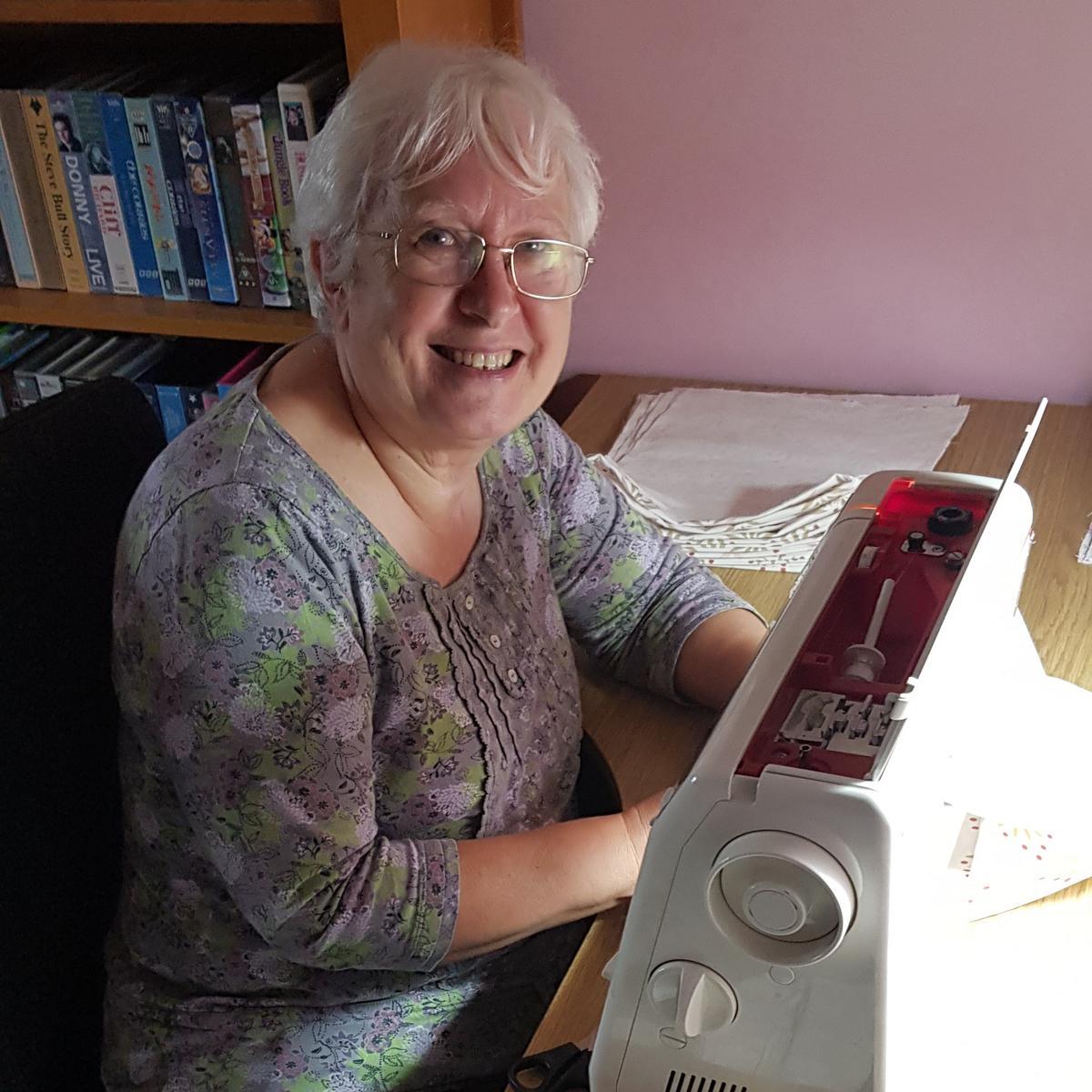 Lynn Lomax sewing on sewing machine