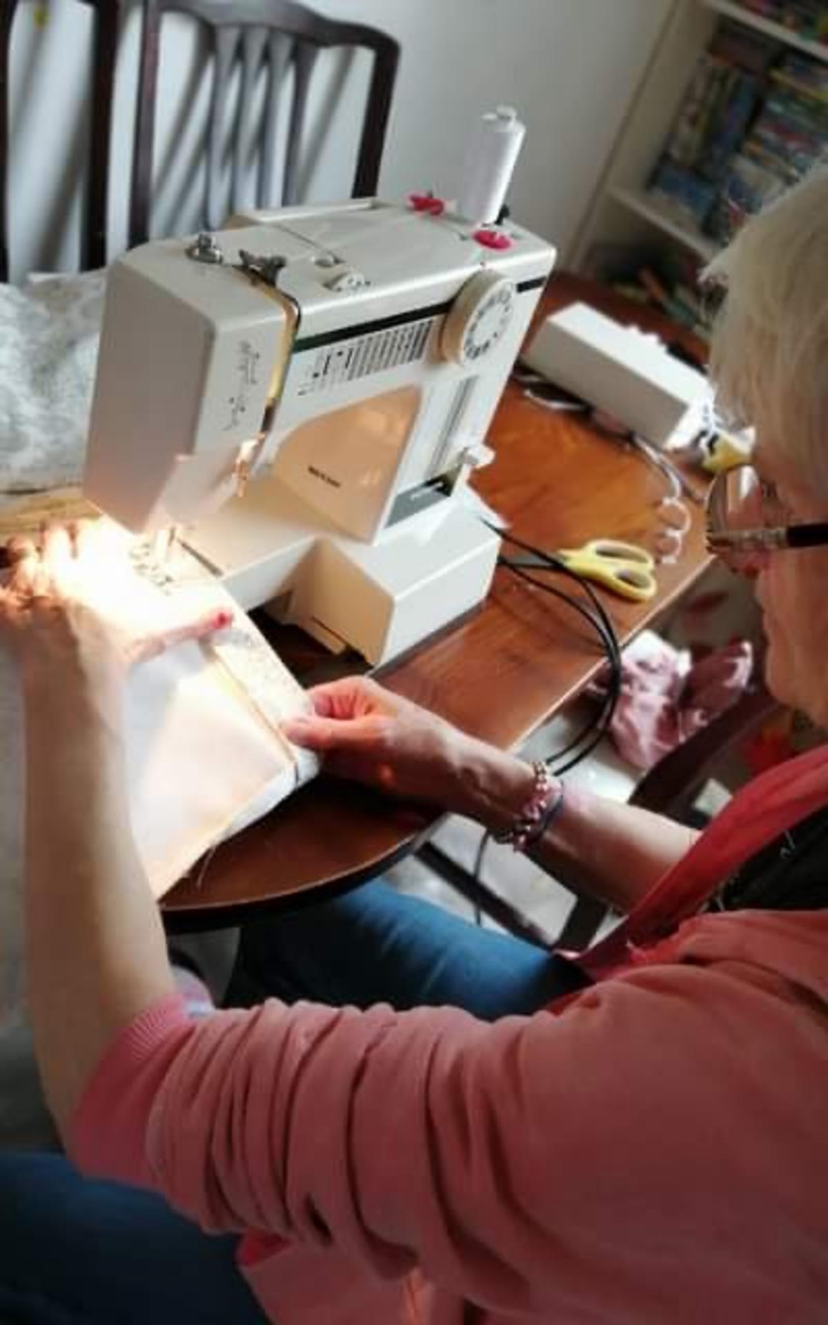 Jo Redworth sewing on sewing machine