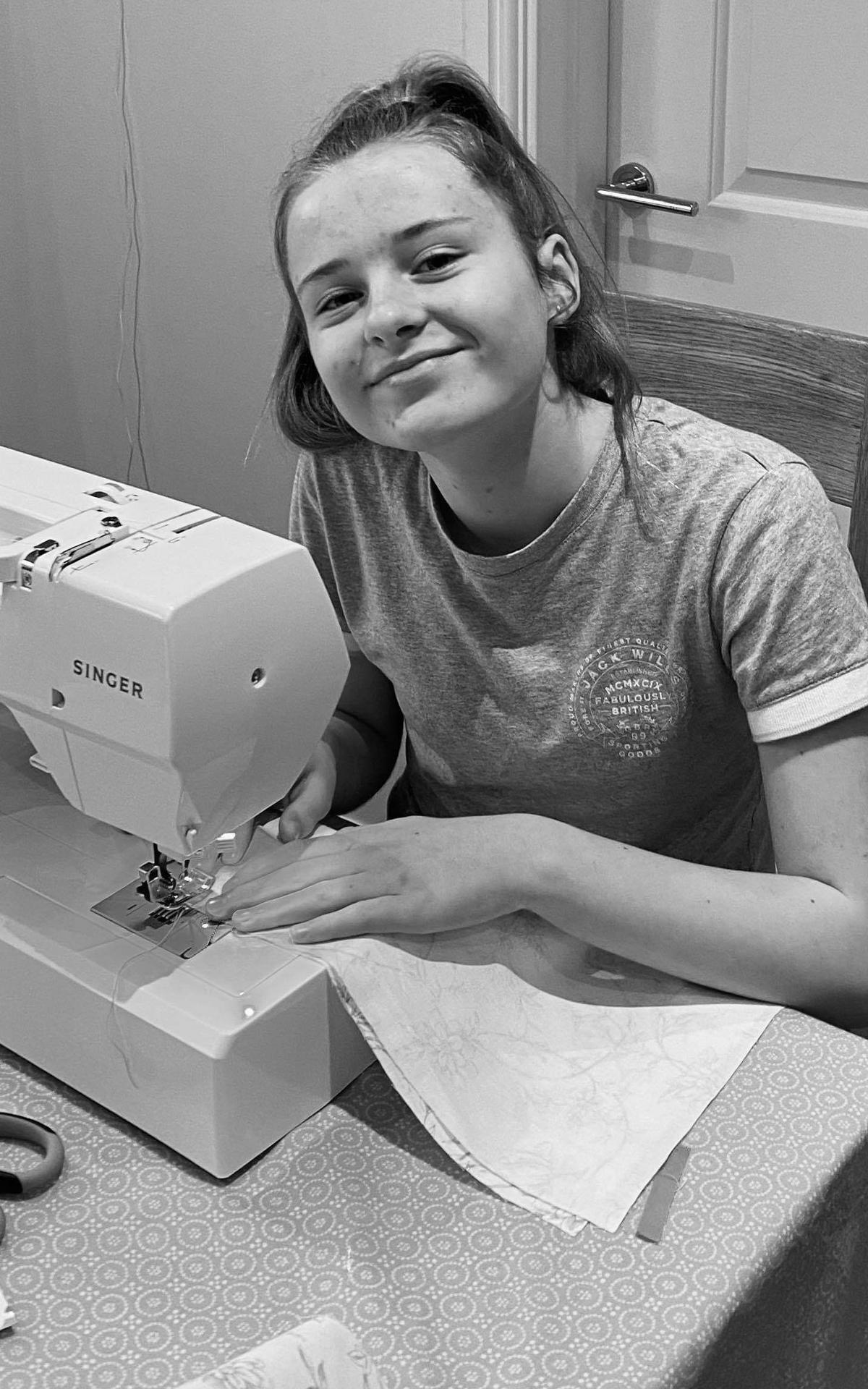 Freya sewing on sewing machine