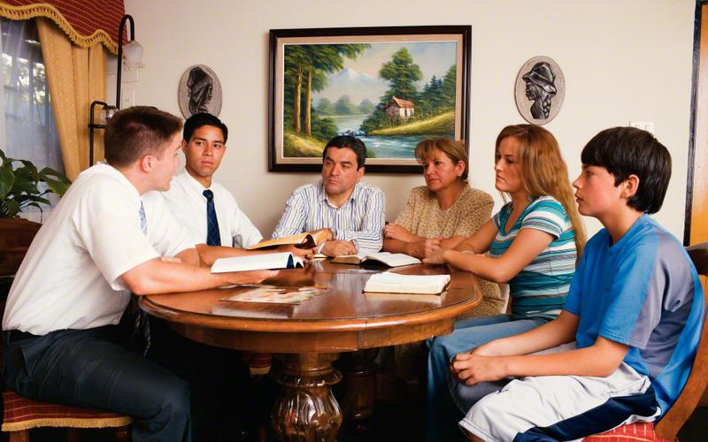 Misioneros en servicio enseñando a una familia