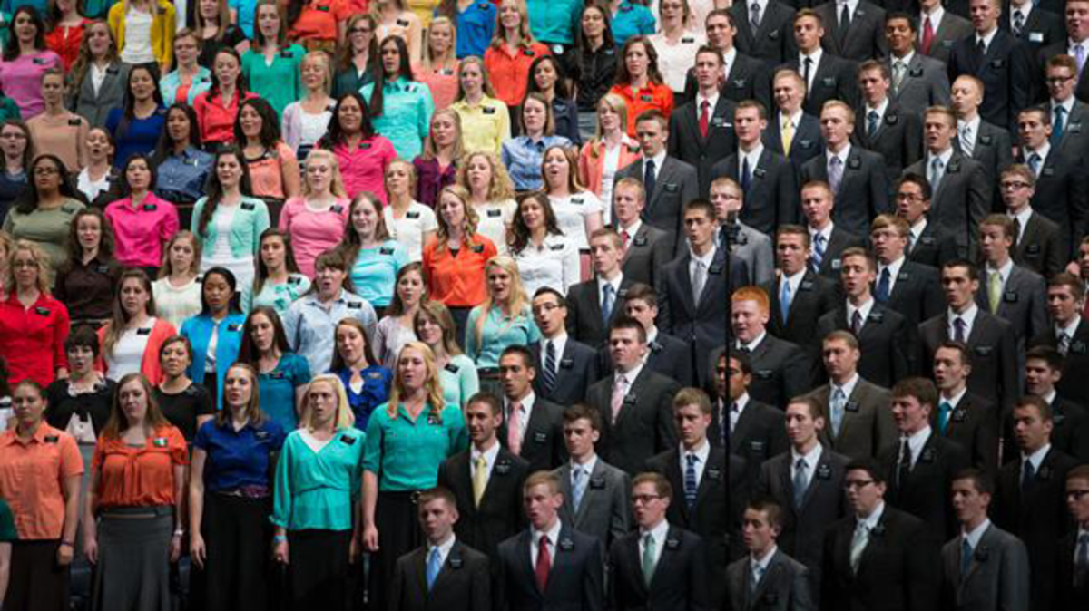 Group of Elder and Sister Missionaries singing as a choir