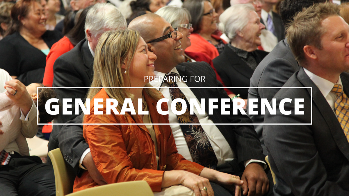 Members sitting inside the conference center during General Conference