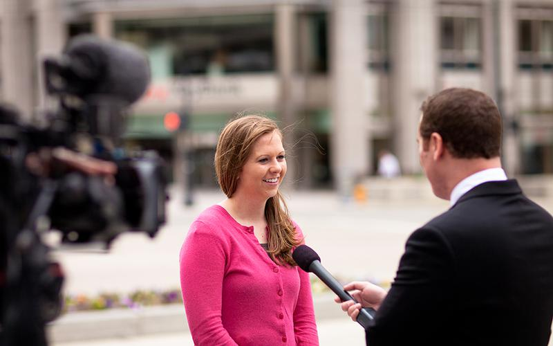A reporter interviewing a girl for church news.