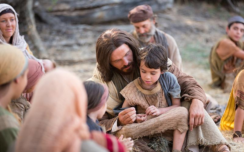 Jesus caring for a child.