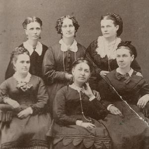 Circa 1872. Top row, left to right: Emmeline B. Wells, assistant secretary; Elizabeth H. Goddard, secretary; Mary W. Musser, treasurer. Bottom row: Margaret T. Mitchell, second counselor; Rachel Ivins Grant, president; Bathsheba W. Smith,  first counselor. Photograph by Charles R. Savage studio. (Church History Library, Salt Lake City.)
