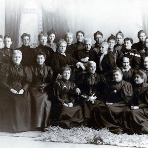 Through her support of women's suffrage, Emmeline B. Wells (standing near center of photograph, with white scarf) won the respect of national suffrage leaders, including Susan B. Anthony (front row, third from right). Anthony and Wells maintained a lifelong friendship. (PH 2296, Church History Library, Salt Lake City.)