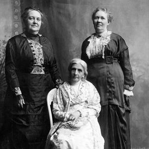 General presidency of the Relief Society from 1910 to 1921. Left to right: Clarissa S. Williams, first counselor; Emmeline B. Wells, seated, president; Julina L. Smith, second counselor. Photograph by the Johnson studio. This photograph appears to have been taken around the same time as a 1914 photograph by the Johnson studio of the presidency with the full board, as the clothing and hairstyles match. (PH 2032, Church History Library, Salt Lake City.)