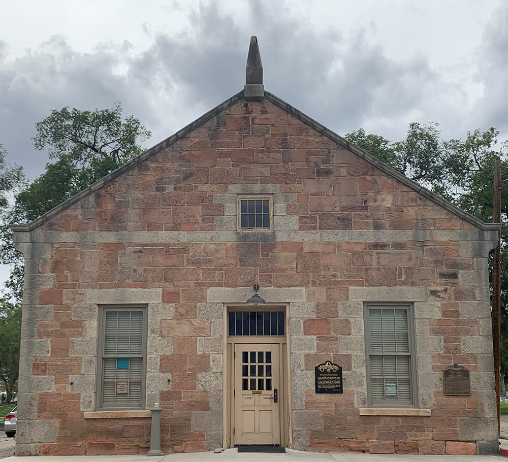 One-story, red stone building