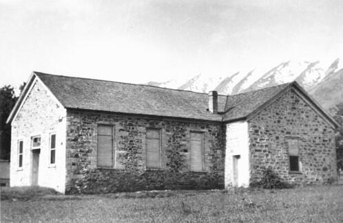 Single-story, stone building with rectangular windows