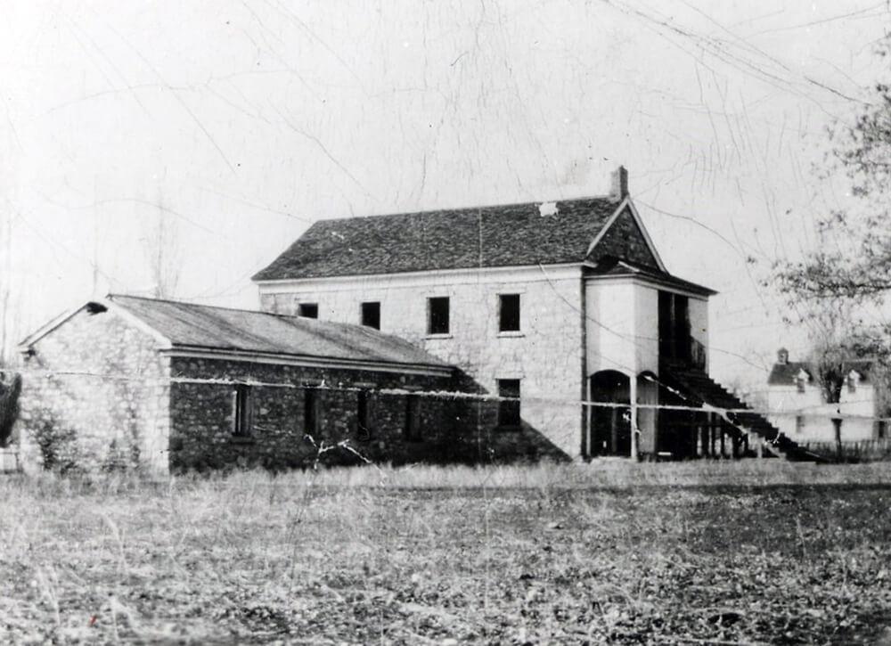 Small, single-story, stone schoolhouse