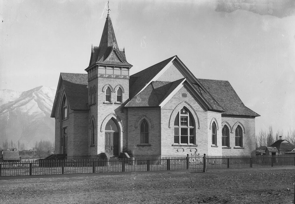 Large, brick building with steeple and arched windows