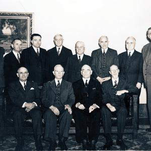 Seated, left to right: Stephen L Richards, Joseph Fielding Smith, George F. Richards, George Albert Smith. Standing: Ezra Taft Benson, Spencer W. Kimball, Harold B. Lee, Charles A. Callis,  Sylvester Q. Cannon, Joseph F. Merrill, John A. Widtsoe, Richard R. Lyman. (Church History Library, Salt Lake City.)