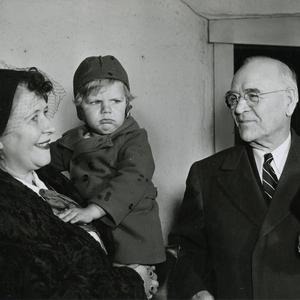 "George F. Richards greeting a ""Sister Moore"" and her son, general conference visitors from Germany. (PH5397, Church History Library, Salt Lake City.)"