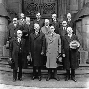 Front row, left to right: Rudger Clawson, Reed Smoot, George Albert Smith, George F. Richards. Middle row: Orson F. Whitney, David O. McKay, Joseph Fielding Smith, James E. Talmage. Back row: Stephen L Richards, Richard R. Lyman, Melvin J. Ballard, John A. Widtsoe.  (Church History Library, Salt Lake City. T778507)
